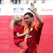 Galatasaray's Johan Elmander celebrate with the trophy after their Turkish Super League soccer match against Trabzonspor at Turk Telekom Arena stadium May 18, 2013.Galatasaray won the Turkish league title for the 19th time. Photo by TURKPIX
