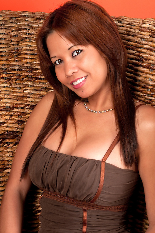 Young oriental woman smiling very sexy.