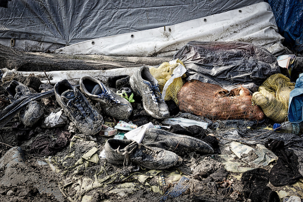 Between 2,600 and 3,000 people lived in atrocious conditions at the Grande- Synthe refugee camp in Dunkirk, France. April 2016 Abandoned boots and shoes left behind as a reminder of the refugee crisis.
