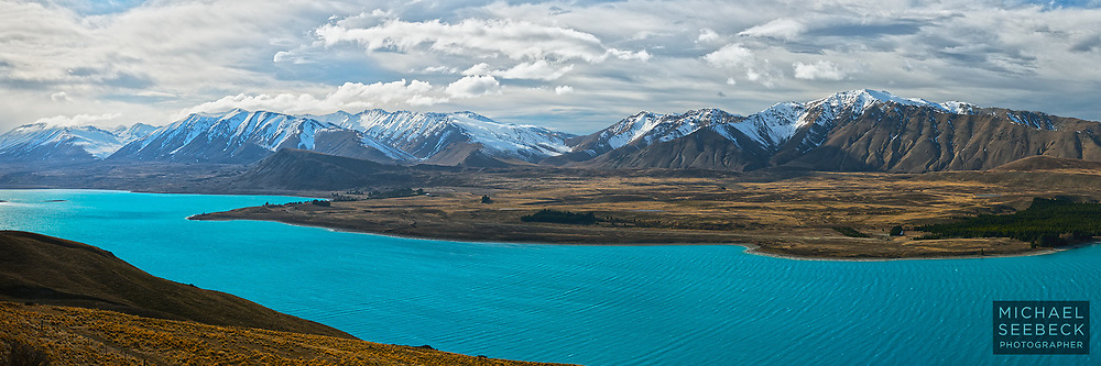 Low clouds scurry across the Tekapo Range ahead of a cold front. Lake Tekapo's beautiful aqua water in the foreground.<br /> <br /> Code: HZCM0003<br /> <br /> Open Edition Print and available as a stock image.
