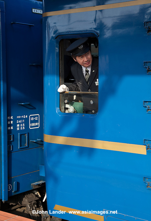 JR Japan Railways Conductor - peering out of his small office window.