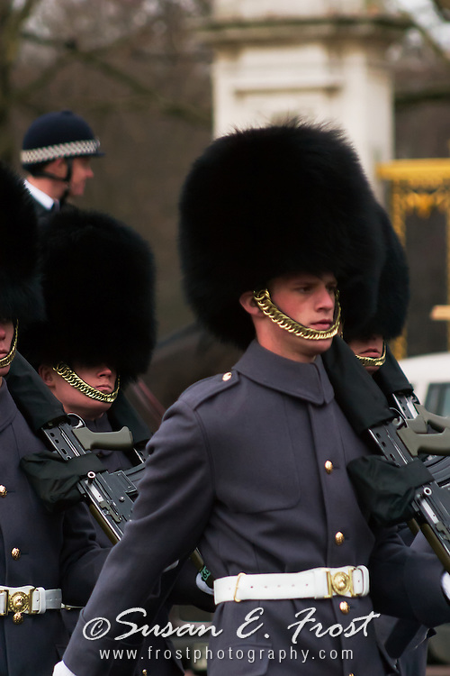 Buckingham Palace guards march toward the palace in London, England.