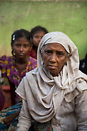 Rasida Khatun, age 70, newly arrived at Kutupalong refugee camp, Bangladesh. She and 33 of her family and neighbors walked 17 days from their village in Myanmar to the border of Bangladesh, fleeing a campaign of ethnic cleansing against Myanmar's Rohingya population.