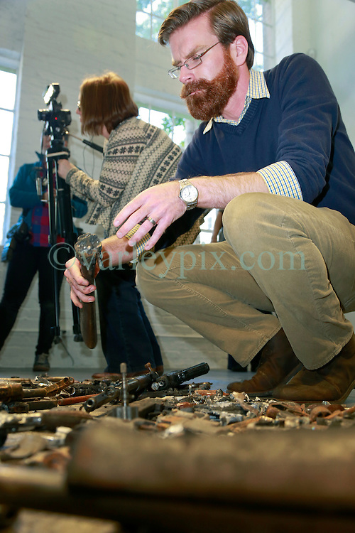 16 April 2014. Jonathan Ferrara Gallery, New Orleans, Louisiana. <br /> L/R; Artist Adam Mysock  at the Jonathan Ferrara Gallery to announce the 'Guns In The Hands Of Artists' project where artists take parts from 190 destroyed weapons acquired by the New Orleans Police department through a buy-back program and convert them into art.  <br /> Photo; Charlie Varley/varleypix.com