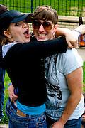 Fun loving revelers age 23 hugging. Grand Old Day Street Fair St Paul Minnesota USA