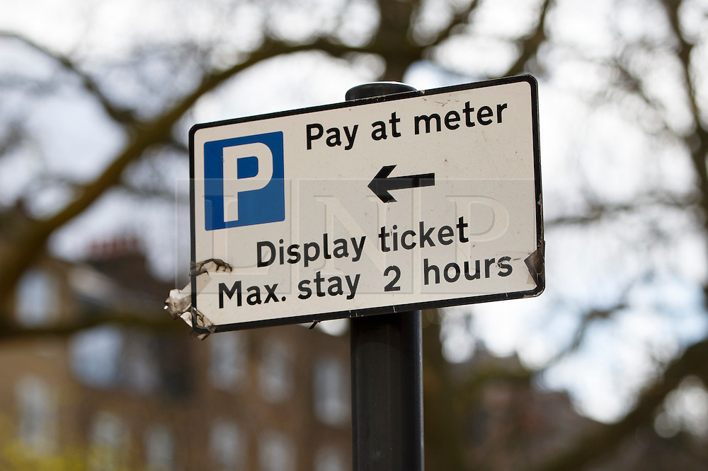 © Licensed to London News Pictures. 30/03/2016. London, UK. A maximum of 2 hours parking sign seen where a fleet of supercars covered in gold chrome wrap are parked in Knightsbridge, London on Wednesday, 30 March 2016. Cars believed to be owned by a tourist from Saudi Arabia. Photo credit: Tolga Akmen/LNP