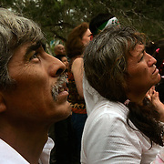 Angel Coronado, left, and his wife Ofelia look towards Alberto Salinas as he begins to call on the spirit of Niño Fidencio in Edinburg. Angel Coronado has spent most of his life as a Fidencista, as a boy he danced as a matachine, or indian dancer, to the folk saint. <br /> Nathan Lambrecht/The Monitor
