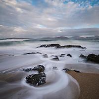Flowing waves across small rocky beach, near Scarista, Isle of Harris, Scotland