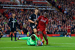 BRITAIN-LIVERPOOL-FOOTBALL-CHAMPIONS LEAGUE-LIVERPOOL VS PSG.(180918) -- LIVERPOOL, Sept. 18, 2018  Liverpool's Sadio Mane (R), Paris Saint-Germain's goalkeeper Alphonse Areola (Below) and Thomas Meunier (2nd R)  fight for the ball during the UEFA Champions League Group C match between Liverpool and Paris Saint-Germain at Anfield Stadium in Liverpool, Britain on Sept. 18, 2018. Liverpool won 3-2.  FOR EDITORIAL USE ONLY. NOT FOR SALE FOR MARKETING OR ADVERTISING CAMPAIGNS. NO USE WITH UNAUTHORIZED AUDIO, VIDEO, DATA, FIXTURE LISTS, CLUB/LEAGUE LOGOS OR ''LIVE'' SERVICES. ONLINE IN-MATCH USE LIMITED TO 45 IMAGES, NO VIDEO EMULATION. NO USE IN BETTING, GAMES OR SINGLE CLUB/LEAGUE/PLAYER PUBLICATIONS. (Credit Image: © Han Yan/Xinhua via ZUMA Wire)