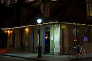 Traditional lamp post and Jazz bar in famous Bourbon Street in French Quarter of New Orleans, USA