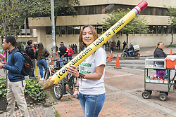 October 10, 2018 - A woman carrying a pencil that says ''with education everything can be done'' in the multitudinous march in the city of Bogotá for Public Education in Colombia (Credit Image: © Daniel Garzon Herazo/ZUMA Wire)