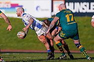 Workington Town prop Stevie Scholey (10) lays the ball off in the tackle during the Ladbrokes Challenge Cup round 3 match between Hunslet Club Parkside and Workington Town at South Leeds Stadium, Leeds, United Kingdom on 24 February 2018. Picture by Simon Davies.