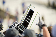Dec 1, 2012; Tulsa, Ok, USA; Member of the Tulsa Hurricanes hold up a trophy following a game against the University of Central Florida Knights at Skelly Field at H.A. Chapman Stadium. Tulsa defeated UCF 33-27 in overtime to win the CUSA Championship. Mandatory Credit: Beth Hall-USA TODAY Sports