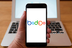 Using iPhone smartphone to display logo of Badoo Chinese social media website