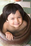 Child bathing inthe flower pot