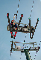 """You can see the """"smile"""" in Tom Beaumont's eyes as he rides the Ramrod Quad for first run on opening day at Gunstock Mountain Resort.  (Karen Bobotas Photo/for The Laconia Daily Sun)"""