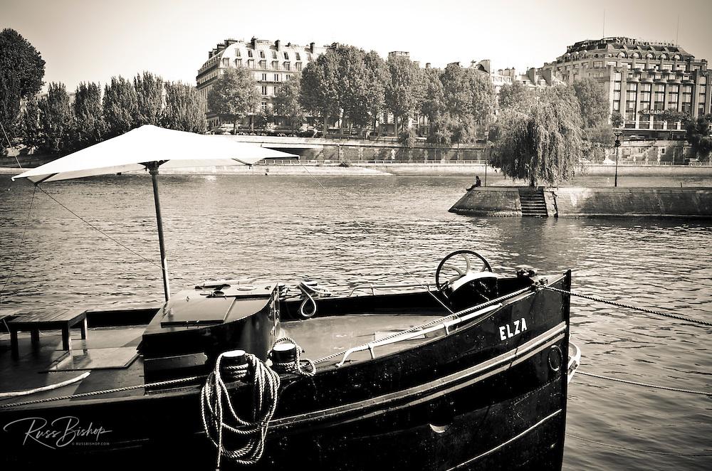 Boat docked along the Seine River, Paris, France