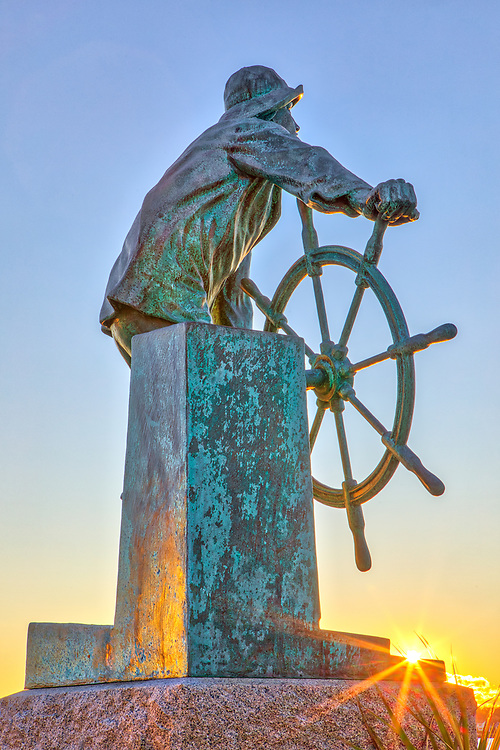 The Gloucester Fisherman's Memorial located at America's Oldest Seaport, Gloucester Harbor on Cape Ann Massachusetts.<br /> <br /> The Gloucester Fisherman's Memorial Gloucester Massachusetts photogarphy pictures available as museum quality photo, canvas, acrylic, wood or metal prints. Wall art prints may be framed and matted to the individual liking and interior design decoration needs:<br /> <br /> https://juergen-roth.pixels.com/featured/the-gloucester-fishermans-memorial-juergen-roth.html<br /> <br /> Good light and happy photo making!<br /> <br /> My best,<br /> <br /> Juergen