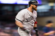 Jonny Gomes #5 of the Boston Red Sox runs to 1st base during a game against the Minnesota Twins on May 17, 2013 at Target Field in Minneapolis, Minnesota.  The Red Sox defeated the Twins 3 to 2.  Photo: Ben Krause