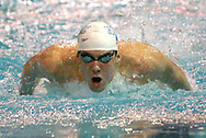 Michael Phelps, of Baltimore, Md., swims to a first-place finish in the men's 200-meter individual medley during the Spring National Championships in Orlando, Florida.