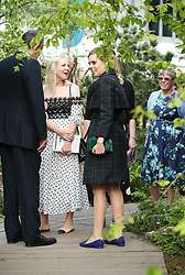 Princess Beatrice of York looks at a display during her visit to the RHS Chelsea Flower Show at the Royal Hospital Chelsea, London.