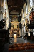 De Nieuwe Kerk is een kerkgebouw in Amsterdam. De kerk is gelegen aan de Dam, naast het Paleis op de Dam.De Nieuwe Kerk wordt, sinds soeverein-vorst Willem in 1814 in deze kerk de eed op de grondwet aflegde, ook gebruikt voor de inzegening van koninklijke huwelijken en voor inhuldigingen. De inhuldiging van Koningin Beatrix vond er plaats op 30 april 1980. Op dezelfde datum in 2013 zal de inhuldiging van haar zoon en opvolger Willem-Alexander ook daar plaatsvinden.<br /> <br /> The New Church is a church building in Amsterdam. The church is located on Dam Square, next to the Palace on the Dam.De New Church in this church in 1814, since sovereign-prince Willem laid aside the oath to the Constitution, also used for the blessing of royal weddings and inaugurations. The inauguration of Queen Beatrix took place on April 30, 1980. On the same date in 2013, the inauguration of her son and heir Willem-Alexander will also take place there.<br /> <br /> Op de foto / On the photo: Binnenkant van kerk met het orgel // Interior of church with the organ