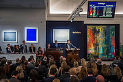 The winning bid comes over the phone via the woman to the left. Sotheby's sale of post-war and contemporary art - highlights include: a group of works from an Important Swedish Private Collection, including Lucio Fontana's rarely seen masterwork, Concetto Spaziale, Attese (1965) Estimate £5,000,000 — 7,000,000 (pictured White, and Robert Rauschenberg's Untitled (Small oil on canvas #4) (1963) Estimate £800,000 — 1,200,000; s a self- portrait diptych by Francis Bacon from 1977 Estimate £13,000,000 — 18,000,000; a monumental and mesmeric Abstraktes Bild by Gerhard Richter Estimate £14,000,000 — 20,000,000 (pictured right); and works by Cy Twombly, Nicolas de Staël, Yves Klein, Jean-Michel Basquiat and Andy Warhol.