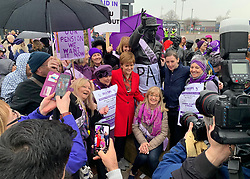 Nicola Sturgeon with people taking part in a demonstration in Glasgow calling for an end to state pension inequality.