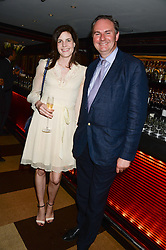 WILLIAM CASH and LADY LAURA CATHCART at a party to celebrate Ben Goldsmith guest-editing the July/August 2013 edition of Spears Magazine held at 45 Park Lane, London on 19th June 2013.