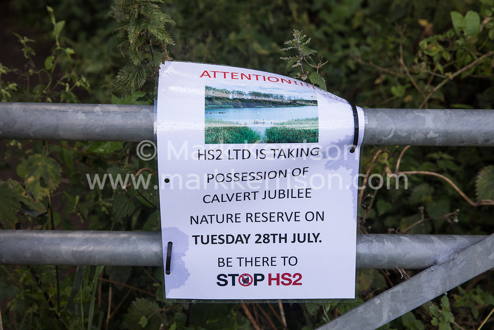 A notice posted by environmental activists from Stop HS2 is seen at Calvert Jubilee Nature Reserve on 27 July 2020 in Calvert, United Kingdom. On 22nd July, the Berks, Bucks and Oxon Wildlife Trust (BBOWT) reported that it had been informed of HS2's intention to take possession of part of Calvert Jubilee nature reserve, which is home to bittern, breeding tern and some of the UK's rarest butterflies, on 28th July to undertake unspecified clearance works in connection with the high-speed rail link.