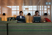 In the British Airways Galleries First lounge at Heathrow Airport's Terminal 5 passengers work on identical DELL laptops