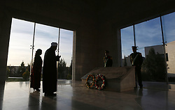 November 9, 2016 - Ramallah, West Bank, Palestinian Territory - A Palestinian man prays in front of the tomb of the late Palestinian leader Yasser Arafat during the inauguration ceremony of late Palestinian leader Yasser Arafat's Museum in the West Bank city of Ramallah on November 9, 2016. The Yasser Arafat Museum opened in Ramallah, shedding light on the long-time Palestinian leader's life and offering a glimpse of history -- along with a number of his trademark black-and-white keffiyehs  (Credit Image: © Shadi Hatem/APA Images via ZUMA Wire)
