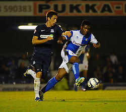 Bristol Rovers' Ellis Harrison battles with Southend United's Luke Prosser - Photo mandatory by-line: Seb Daly/JMP - Tel: Mobile: 07966 386802 27/09/2013 - SPORT - FOOTBALL - Roots Hall - Southend - Southend United V Bristol Rovers - Sky Bet League Two