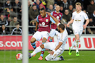 Aston Villa's Jordan Ayew (l) is tackled by Swansea's Ashley Williams. Barclays Premier league match, Swansea city v Aston Villa at the Liberty Stadium in Swansea, South Wales on Saturday 19th March 2016.<br /> pic by  Carl Robertson, Andrew Orchard sports photography.