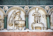 Late medieval relief sculpture depicting the labours for October and september and astrological signs on the Facade of the Cattedrale di San Martino,  Duomo of Lucca, Tunscany, Italy, .<br /> <br /> Visit our ITALY HISTORIC PLACES PHOTO COLLECTION for more   photos of Italy to download or buy as prints https://funkystock.photoshelter.com/gallery-collection/2b-Pictures-Images-of-Italy-Photos-of-Italian-Historic-Landmark-Sites/C0000qxA2zGFjd_k<br /> <br /> <br /> Visit our MEDIEVAL PHOTO COLLECTIONS for more   photos  to download or buy as prints https://funkystock.photoshelter.com/gallery-collection/Medieval-Middle-Ages-Historic-Places-Arcaeological-Sites-Pictures-Images-of/C0000B5ZA54_WD0s .<br /> <br /> If you prefer to buy from our ALAMY PHOTO LIBRARY  Collection visit : https://www.alamy.com/portfolio/paul-williams-funkystock/lucca.html .