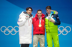 PYEONGCHANG-GUN, SOUTH KOREA - FEBRUARY 24: Silver medal winner Sang-ho Lee of South Korea, gold medal winner Nevin Galmarini of Switzerland and bronze medal winner Zan Kosir of Slovenia celebrate during the medal ceremony for Men's Snowboard Parallel Giant Slalom on day fifteen of the PyeongChang 2018 Winter Olympic Games at Medal Plaza on February 24, 2018 in Pyeongchang-gun, South Korea. Photo by Ronald Hoogendoorn / Sportida