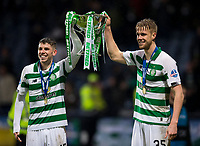 Football - 2019 Betfred Scottish League Cup Final - Celtic vs. Rangers<br /> <br /> Ryan Christie of Celtic and Kristoffer Ajer of Celtic lift the trophy, Hampden Park Glasgow.<br /> <br /> COLORSPORT/BRUCE WHITE