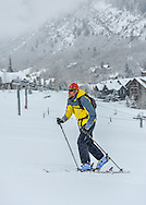 Erik Skarvan skins up Aspen Highlands in Aspen, Colorado.