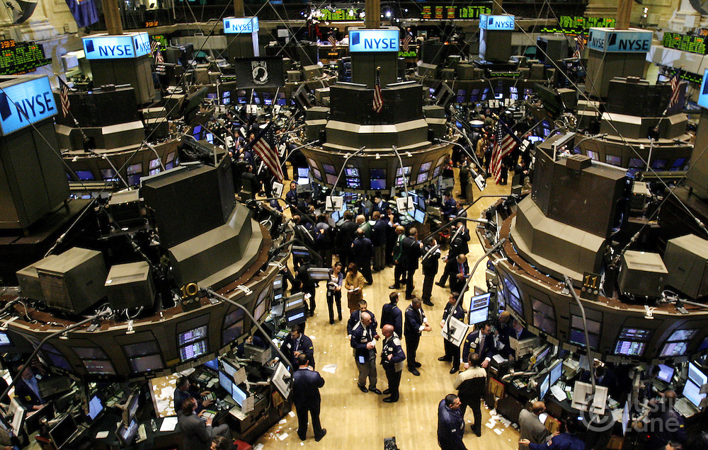 Traders works on the floor of the New York Stock Exchange at the end of trading in New York, New York on Tuesday 27 February 2007. The Dow Jones Industrial average ended down 416 points, about 3 percent, after China's equity market tumbled today.