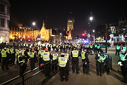 © Licensed to London News Pictures . 05/11/2016 . London , UK . Police in front of Parliament . Supporters of Anonymous , many wearing Guy Fawkes masks , attend the Million Mask March bonfire night demonstration , in central London . Photo credit : Joel Goodman/LNP