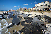 What is left of 2nd Street in Ocean Isle Beach, NC where the ocean has reclaimed land, homes and a large section of 2nd Street due to rising tides and erosion. About 3,800 homes are packed together on the narrow seven-mile long Ocean Isle. The rising ocean has worn away at the eastern end, where streets and lots have been steadily disappearing.