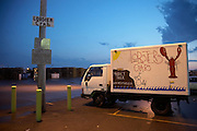 Newport RI - Seafood delivery truck in state fishing pier paking lot at dusk.