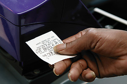 Close up of a ticket being punched on the bus,