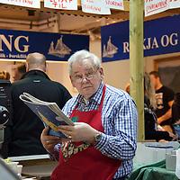 Meat vendor at the Kolaportið on December 21, 2013.