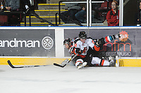 KELOWNA, CANADA, OCTOBER 11: Patrik Parkkonen #24 of the Medicine Hat Tigers checks Tyrell Goulbourne #12 of the Kelowna Rockets into the boards as the Medicine Hat Tigers visited the Kelowna Rockets on October 11, 2011 at Prospera Place in Kelowna, British Columbia, Canada (Photo by Marissa Baecker/shootthebreeze.ca) *** Local Caption ***Patrik Parkkonen;Tyrell Goulbourne;