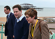 © Licensed to London News Pictures. 10/03/2013. Brighton, UK. Nick Clegg, Liberal Democrat Leader and Deputy Prime Minister walks along Brighton seafront with his Deputy Chief of Staff, Jo Foster, before giving his keynote speech to the Liberal Democrat Spring Conference in Brighton today 10th March 2013. Photo credit : Stephen Simpson/LNP