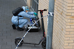 © Licensed to London News Pictures 30/07/2021. Greenwich, UK. Third crime scene Victoria Parade junction with Thames Street with a scooter inside the scene. A police investigation has been launched after a double stabbing in Greenwich, London which has left on man dead and another in a life-threating condition in hospital. A large cordon is in place with police forensic officers working three crime scenes near the Cutty Sark. Photo credit:Grant Falvey/LNP