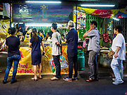 20 OCTOBER 2017 - BANGKOK, THAILAND: People line up for vegetarian food in Talat Noi neighborhood of Chinatown in Bangkok on the first day of the Vegetarian Festival, what Thais call the Taoist Nine Emperor Gods Festival, in the Chinatown neighborhood of Bangkok, Thailand. It is a nine-day Taoist celebration beginning on the eve of 9th lunar month of the Chinese calendar. For nine days people participating in the festival wear only white and don't eat meat, poultry, seafood, and dairy products. The vegetarian festival is celebrated throughout Thailand, but especially in Phuket and Bangkok, cities with large ethnic Chinese communities.       PHOTO BY JACK KURTZ