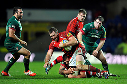 Dean Schofield of London Welsh is tackled to ground - Photo mandatory by-line: Patrick Khachfe/JMP - Mobile: 07966 386802 23/11/2014 - SPORT - RUGBY UNION - Oxford - Kassam Stadium - London Welsh v Leicester Tigers - Aviva Premiership