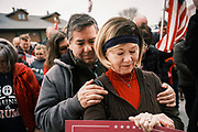 """06 DECEMBER 2020 - DES MOINES, IOWA: People pray during a rally in support of President Donald Trump. About 1,000 supporters of outgoing US President Donald Trump rallied in Des Moines Sunday to show their support for the President and to protest the outcome of the US Presidential election. They started with a rally in the suburbs of Des Moines then drove in a motorcade through the city, ending at the State Capitol. They repeated many of Trump's discredited claims that the election was marked by fraud and that Trump actually won. The protest was a part of the national """"March for Trump"""" effort, culminating in a march in Washington DC on December 13. Joe Biden won the election, with 306 electoral votes to Trump's 232.       PHOTO BY JACK KURTZ"""